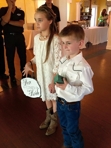 Flower girl in cowboy boots and a ring bearer at House Plantation