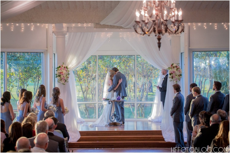 Loving embrace at an indoor wedding at House Plantation