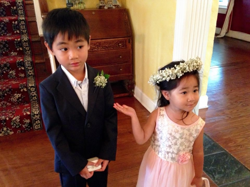 adorable flower girl introducing ring bearer