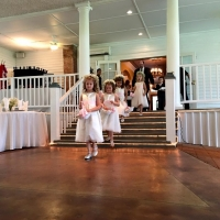 Adorable flower girl train at an indoor wedding at House Plantation