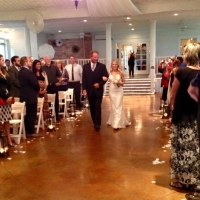 Summer walk down the aisle adorned with rose petals