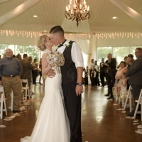 a wedding kiss after the vows at House Plantation