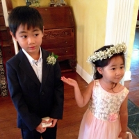 adorable flower girl introducing ring bearer