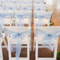 chair pics with blue sashes by Eric & Jenn Photography
