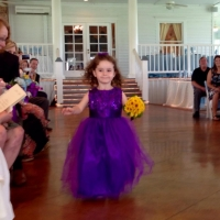 flower girl in bright blue-purple