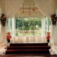 indoor wedding altar with flowers
