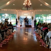 taking vows at an indoor wedding with an interesting backdrop