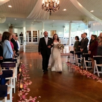 walking the aisle aligned with rose petals and lanterns in october at House Plantation