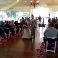 walking the aisle and soft pink rose petals
