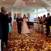 walking the aisle with white and yellow rose petals