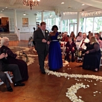 white rose petals and wedding party.JPG