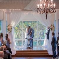 Loving embrace at an indoor wedding at House Plantation