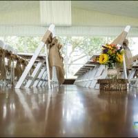 Rustic aisle markers at an indoor wedding at House Plantation