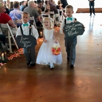flower girl and ring bearers walking down the aisle at House Plantation