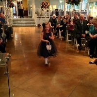 flower girl in an indoor january wedding-pinterest-twitter