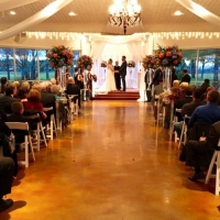 incredible glass stands and aisle markers in a january indoor wedding