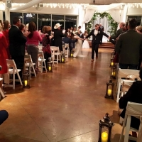 indoor wedding at night in Dec after saying I do