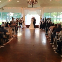 vows in August with aisle lined with feathers