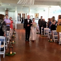 walking the aisle in oct aligned with elegant lanterns