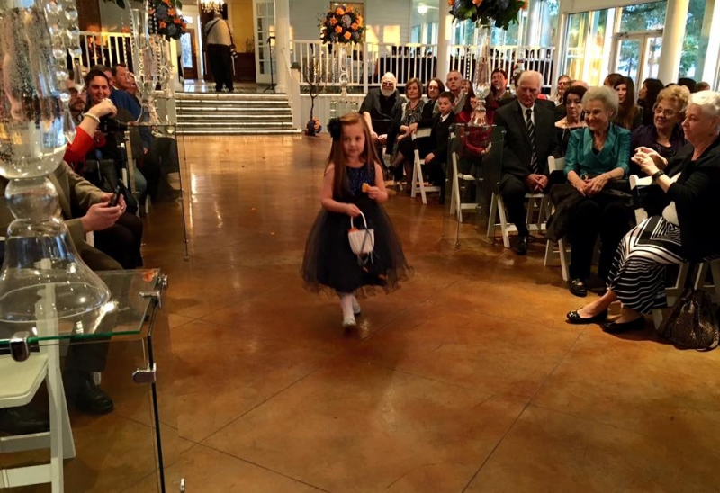 flower girl in an indoor january wedding-pinterest-twitter