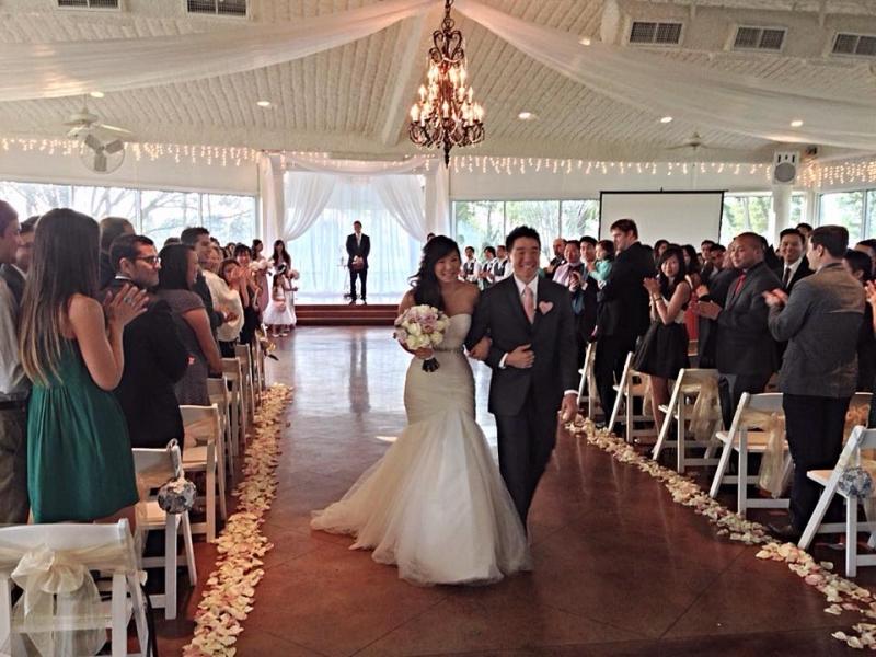 indoor wedding walking down the aisle