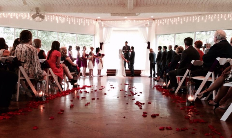 red rose petals and holding hands and saying I do