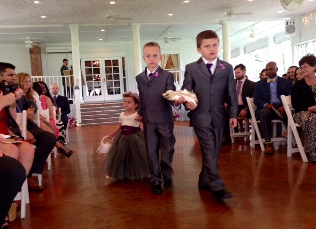 ringbearer helping the flower girl down the aisle.jpeg