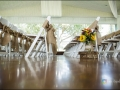 Rustic aisle markers at an indoor wedding at House Plantation