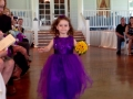 flower girl in bright blue-purple