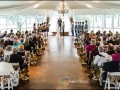 taking vows at indoor wedding with breathtaking outdoor venues at a Houston facility