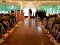 wedding in November with aisle with rose petals and lanterns