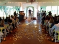 yellow and white rose petals, yellow sashes, and saying I do