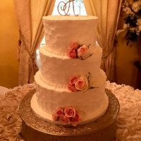 3-tiered cake with roses and a monogram at House Plantation