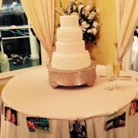 wedding cakes with pictures surrounding it