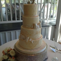4 tier wedding cake with beading and ribbons