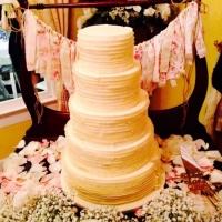 5 tiered beige cake.jpg