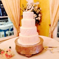 beautiful and sleek wedding cake with beading.jpg