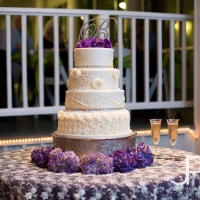 perfect four tiered wedding cake with purple flowers