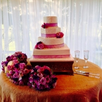 sleek wedding cake with beautiful purple and pink flowers