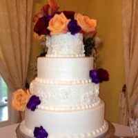 wedding cake with bright and vivid flowers