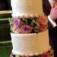 wedding cake with roses and bride and groom.JPG