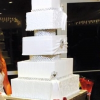white squared five tiered cake