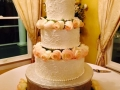 Beige roses and a three tiered cake at House Plantation
