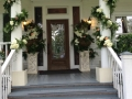 Entrance with flowers galore at House Estate