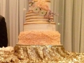 beautiful 5 tiered cake with soft pallet of flowers
