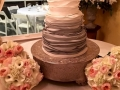beautiful wedding cake with pastel colors surrounding it