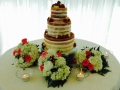 wedding dessert cake with fruit, flowers and candles