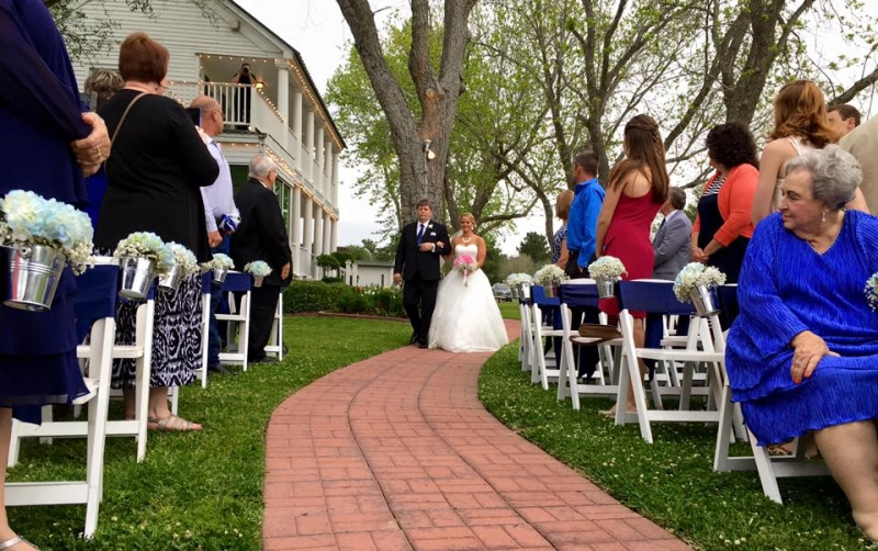 Father walking the bride at an outdoor wedding with trees galore at House Plantation