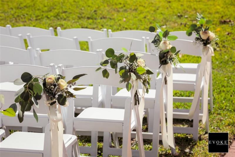 Outdoor-wedding-chairs-with-flowers-min