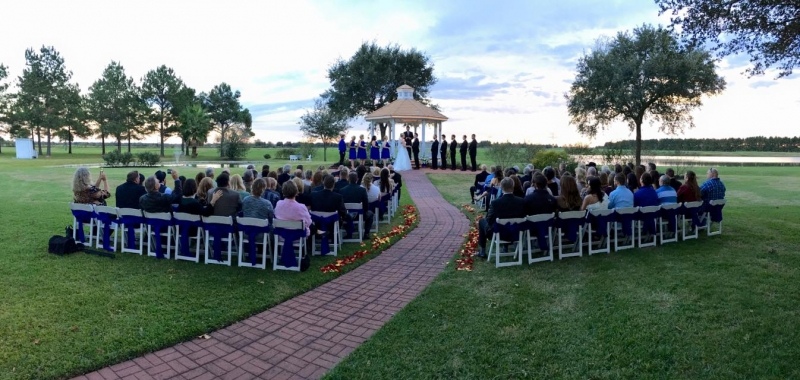 Royal blue sashes,rose petals and an outdoor wedding at House Plantation